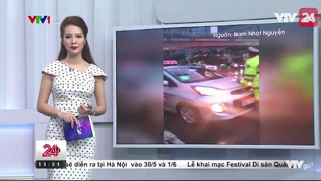 Lái xe taxi cố tình húc vào cảnh sát để cản trở đoàn xe ưu tiên | VTV24