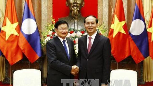Chịch tịch nước Trần Đại Quang tiếp Thủ tướng Lào