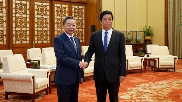 Chủ tịch Quốc hội Trung Quốc tiếp Bộ trưởng Tô Lâm